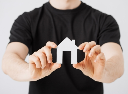 picture of man hands holding paper house Stock Photo - 20074994