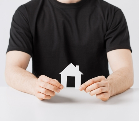 picture of man hands holding paper house Stock Photo - 20074804