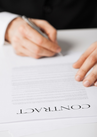 municipal utilities: picture of man hands signing contract
