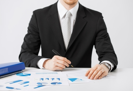 cashflow: picture of businessman working and signing with papers