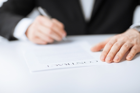 legal services: picture of man hands signing contract
