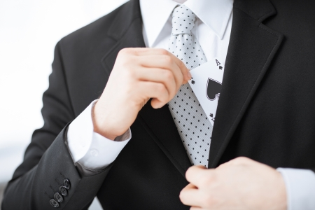 hand in pocket: close up of mans hand hiding ace in the jacket pocket