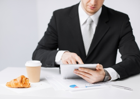 close up of man with tablet pc and cup of coffee Stock Photo - 20074819