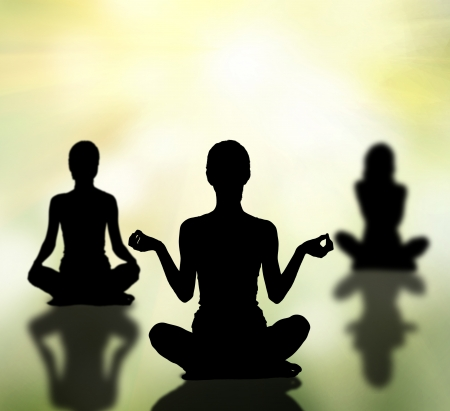 home trainer: silhouettes of three women practicing yoga lotus pose