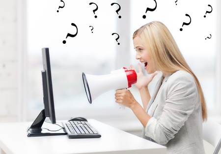 pissed: picture of strict businesswoman shouting in megaphone Stock Photo