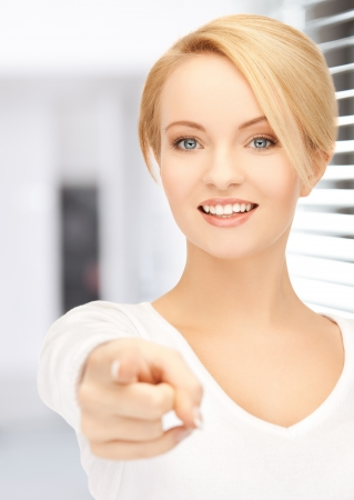 picture of attractive businesswoman pointing her finger at you Stock Photo - 20112298