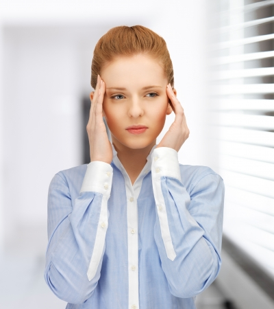 stressed woman holding her head with hands Stock Photo - 20112360