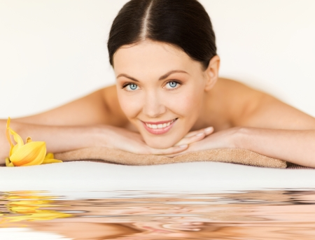 picture of happy relaxed woman in spa salon photo