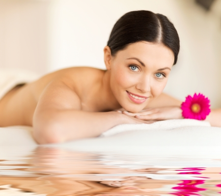 anti aging: picture of happy relaxed woman in spa salon