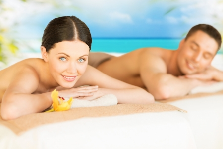 picture of couple in spa salon lying on the massage desks photo
