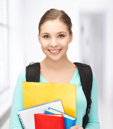 high up: bright picture of smiling student with books and schoolbag