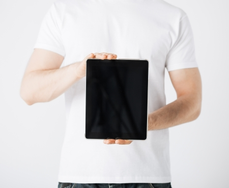 close up of man with tablet pc photo
