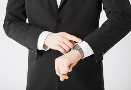 wasting: close up of man looking at wristwatch