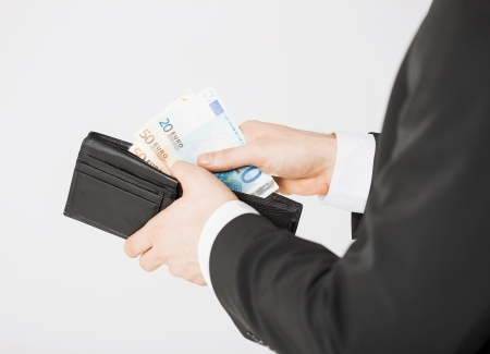 picture of man hands with purse counting euro cash money photo
