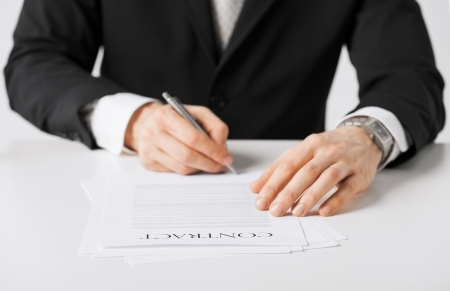 picture of man hands signing contract photo