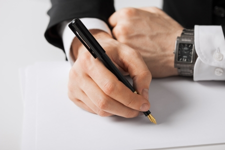 old writing: picture of businessman writing something on the paper