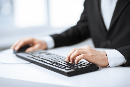 e work: picture of man hands typing on keyboard Stock Photo