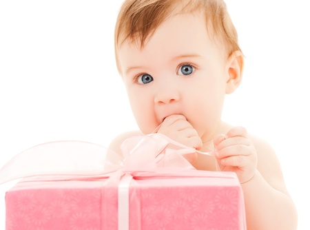 xmas baby: bright picture of happy child with gift box