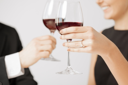 cheers: picture of engaged couple with wine glasses in restaurant Stock Photo