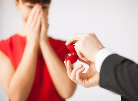 proposing: picture of couple with wedding ring and gift box