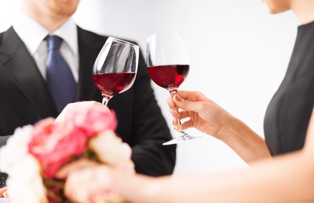 picture of engaged couple with wine glasses in restaurant photo