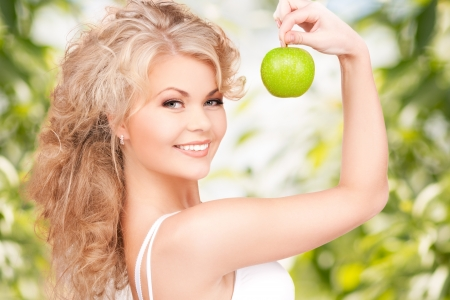 woman apple: picture of young beautiful woman with green apple