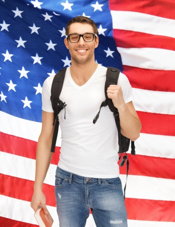 bright picture of travelling student with backpack and book over american flag photo