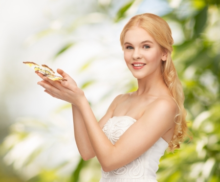 picture of beautiful woman with butterfly in hand photo