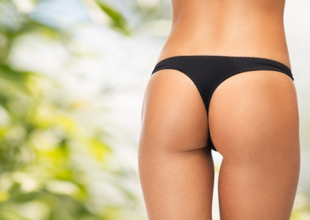 body curve: picture of female legs in black bikini panties Stock Photo