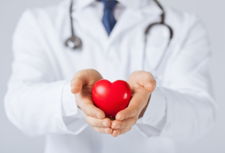 family doctor: close up of man hands with heart