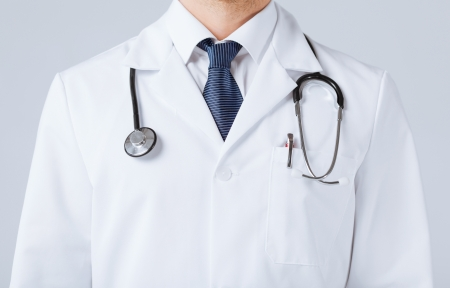 bright close up of male doctor with stethoscope Stock Photo
