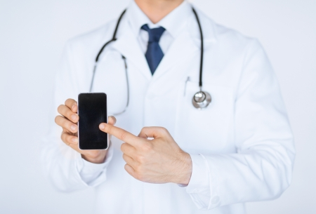 pointing device: close up of male doctor pointing at smartphone