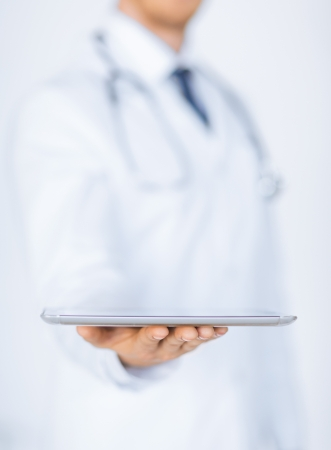 close up of male doctor holding tablet pc photo