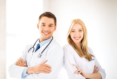 physiotherapists: bright picture of two young attractive doctors