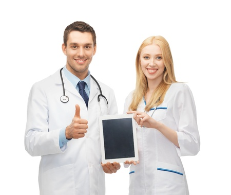 modern doctor: two young doctors holding tablet pc in hands