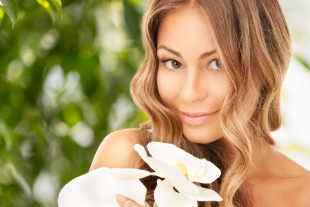 picture of beautiful woman with orchid flower Stock Photo - 20328110