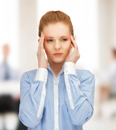 stressed woman holding her head with hands Stock Photo - 20206570