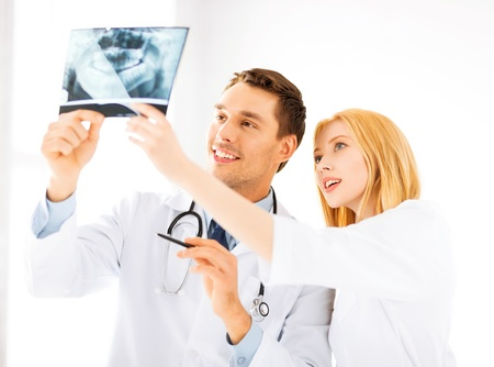 picture of two doctors looking at x-ray photo