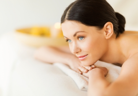 salon spa: picture of woman in spa salon lying on the massage desk