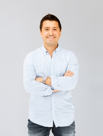 portrait of handsome smiling man in casual shirt photo