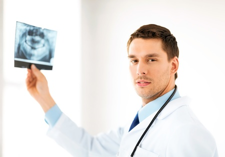 radiology: picture of male doctor or dentist with x-ray Stock Photo