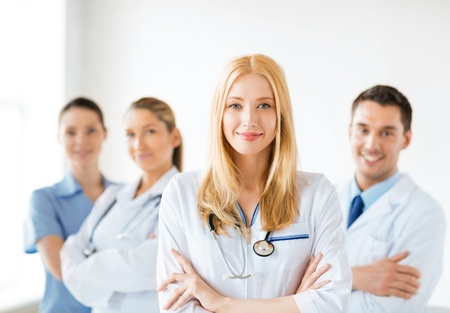 physiotherapists: attractive female doctor in front of medical group Stock Photo