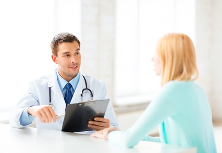gynecologist: bright picture of male doctor with patient Stock Photo