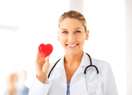 cardiologist: bright picture of female doctor with heart Stock Photo