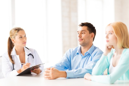 desease: bright picture of doctor with patients in cabinet Stock Photo