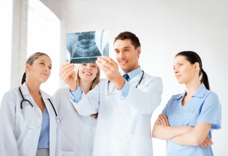 dentists: picture of young group of doctors looking at x-ray Stock Photo