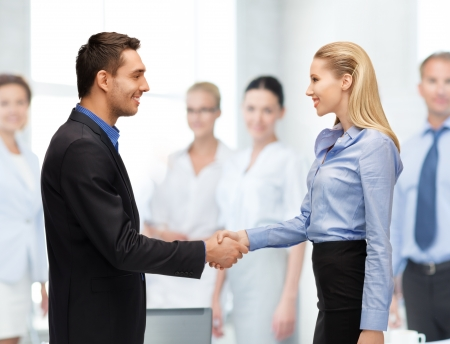 bright picture of man and woman shaking their hands Stock Photo - 20362812