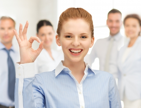 bright picture of young woman showing ok sign Stock Photo - 20362809