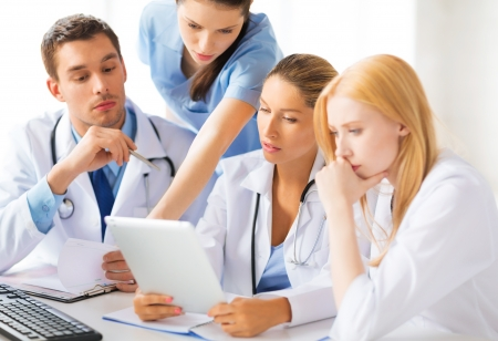 healthcare office: picture of young team or group of doctors working