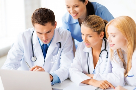 medical cabinet: picture of young team or group of doctors working